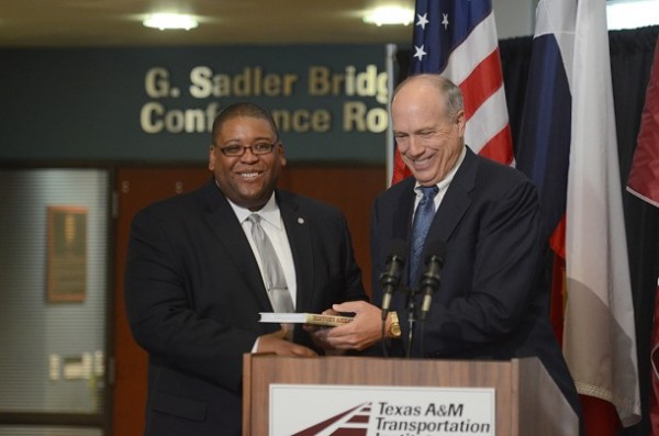David Strickland, administrator for the National Highway Traffic Safety Administration, and TTI Director Dennis Christiansen.